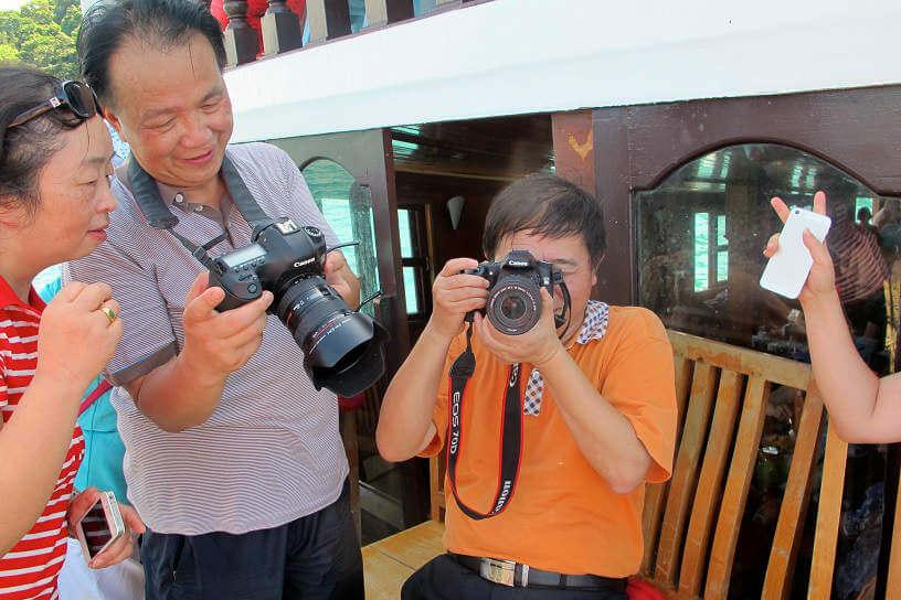 Tour group taking photos in Cambodia