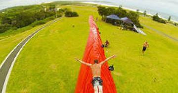 Dan sliding down a slip and slide on Australia Day