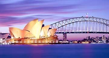 Sydney harbour bridge and opera house at dusk