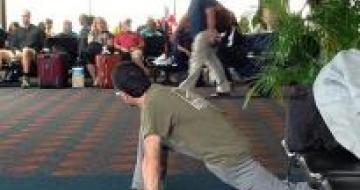 Man stretching in Airport