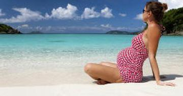 Thumbnail image of a pregnant lady sitting on the beach