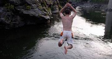 Thumbnail image of man jumping off rock into water at Nagatoro, Japan