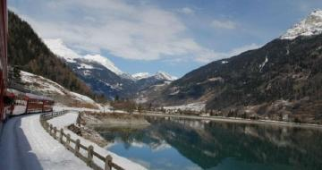 View of Snow-Capped Mountains and Water from the Bernina Express train