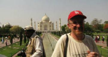 Man standing in front of the Taj Mahal