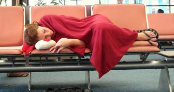 Lady asleep at the airport