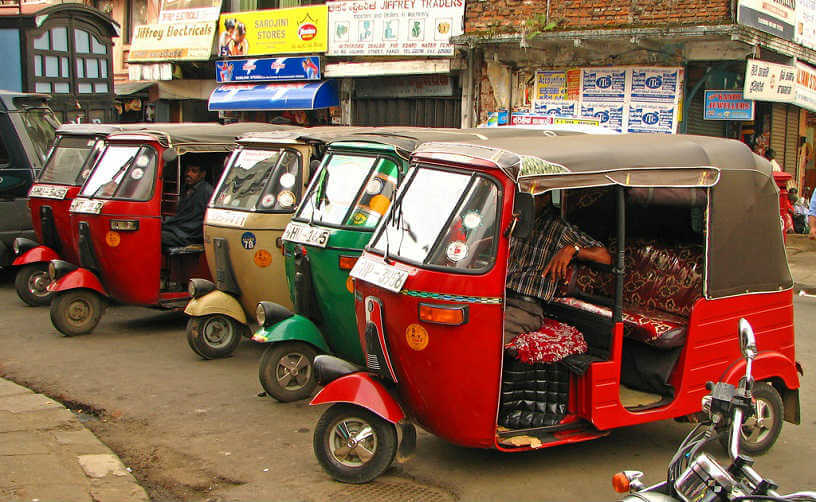 Tuk-tuks waiting for fares in Kandy, Sri Lanka