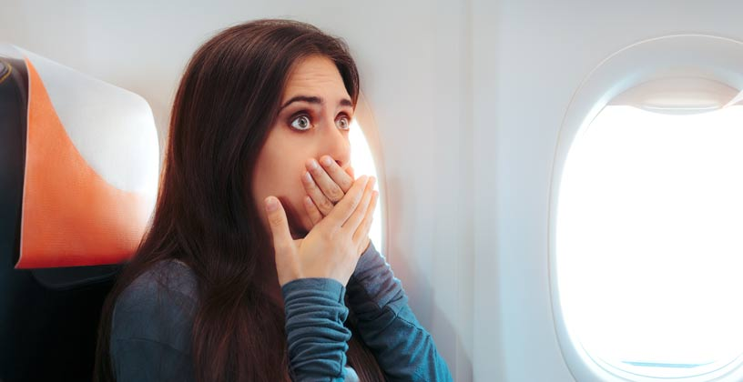 Woman on plane feeling sick